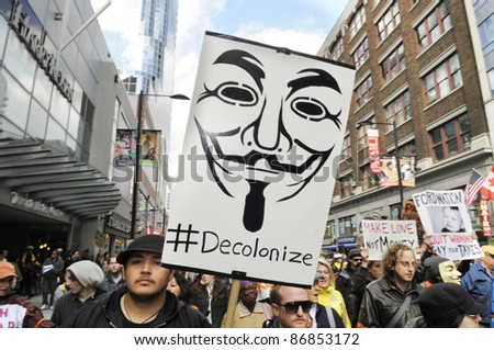 TORONTO - OCTOBER 17:  Protestors walking in a rally  during the Occupy Toronto Movement on October 17, 2011 in Toronto, Canada. - stock photo