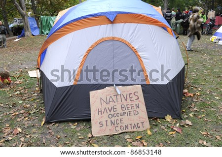 TORONTO - OCTOBER 17:  Temporary tents at the St.Johns Park  stating the occupation on Aboriginals during the Occupy Toronto Movement on October 17, 2011 in Toronto, Canada. - stock photo
