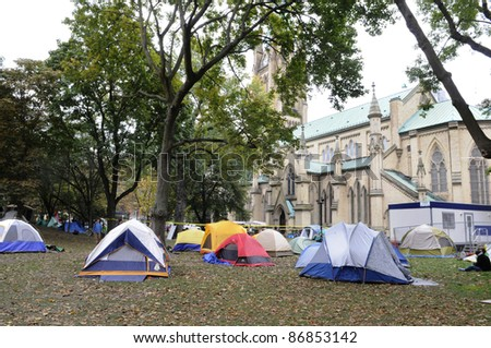 TORONTO - OCTOBER 17: Temporary tents set up  at the St. James Park during the Occupy Toronto Movement on October 17, 2011 in Toronto, Canada. - stock photo