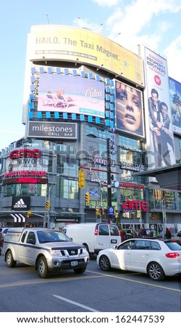 TORONTO - OCTOBER 20: Traffic in Dundas Square on October 20, 2013 in Toronto. Dundas Square is a commercial and public square that hosts many events and it is one of Toronto's main attraction. - stock photo