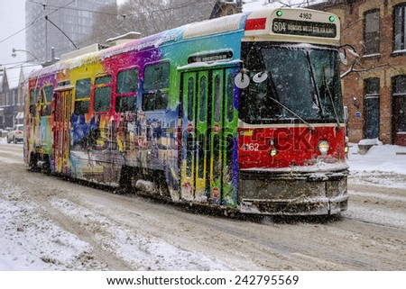 TORONTO, ON/CANADA-DECEMBER 11TH 2014 Photos of the Toronto street car traveling westbound on Queen Street between River Street and Sumach, in the first snow storm of the winter season.  - stock photo