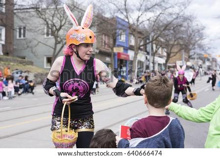 Toronto ontariocanada apr 16 2017 woman stock photo 640666474 toronto ontariocanada apr 16 2017 woman in easter costume distributes negle Gallery