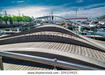 Toronto, Ontario, Canada, Aug. 15, 2015, beautiful amazing gorgeous view of wooden hill against waterfront with parked yachts and blue sky background on sunny summer day