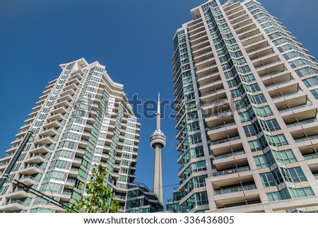 Toronto, Ontario,Canada, Aug. 15, 2015, great amazing beautiful view of modern inviting condo buildings with CN tower between against deep blue sky background in downtown Toronto