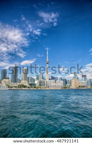 Toronto, Ontario, Canada, August 12, 2016: Toronto as seen from Lake Ontario. The city continues building as a housing boom pushes prices ever higher.