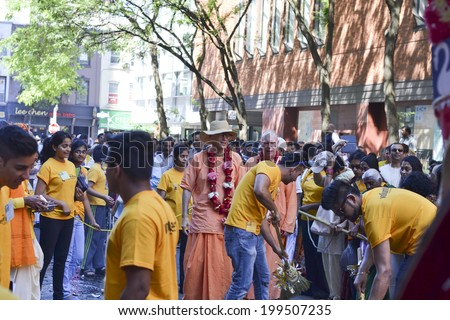 TORONTO, ONTARIO/CANADA - JULY 13: Devotees of Lord Krishna celebrating during the 41st Annual Festival of India on July 13, 2013 in Toronto,Canada.  - stock photo
