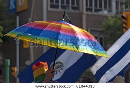 TORONTO, ONTARIO, CANADA - JULY 3: Umbrella with Pride rainbow colors carried by an unknown participant at the 2011 Annual Gay Pride Parade in Toronto on July 3, 2011.