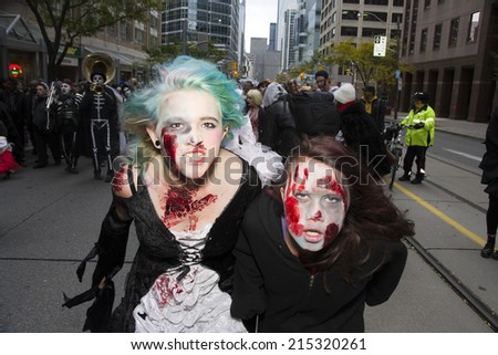 TORONTO, ONTARIO/CANADA - 26th SATURDAY  OCTOBER 2013 : Hundreds of the undead braved the cold weather and gathered outside Nathan Philips Square to mingle with fellow zombies in Toronto,Canada.  - stock photo