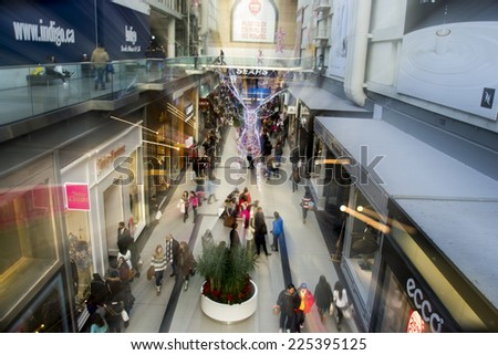 TORONTO, ONTARIO/CANADA - 26th Thursday December 2013 : Shoppers make their way through the Eaton Centre as they visit the Boxing Day sales in Toronto,Canada.
