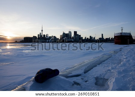 Toronto Ontario from Polson Pier in Winter at sunset - stock photo