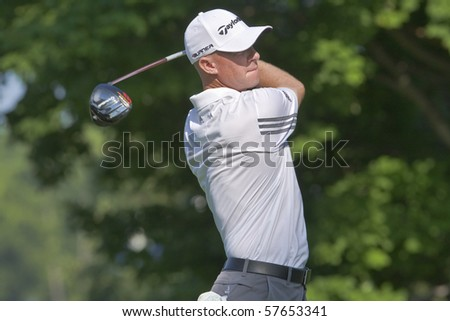 TORONTO, ONTARIO - JULY 21: Australian golfer Nathan Green follows his tee shot during a pro-am event at the RBC Canadian Open golf on July 21, 2010 in Toronto, Ontario. - stock photo