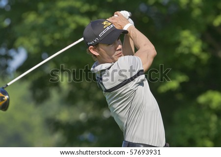 TORONTO, ONTARIO - JULY 21: Colombia-born golfer Camilo Villegas follows his tee shot during a pro-am event at the RBC Canadian Open golf on July 21, 2010 in Toronto, Ontario. - stock photo
