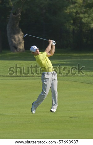 TORONTO, ONTARIO - JULY 21:English golfer Paul Casey hits an approach shot during a pro-am event at the RBC Canadian Open golf on July 21, 2010 in Toronto, Ontario. - stock photo