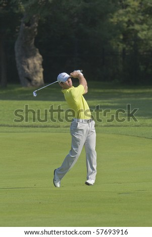 TORONTO, ONTARIO - JULY 21:English golfer Paul Casey hits to a green during a pro-am event at the RBC Canadian Open golf on July 21, 2010 in Toronto, Ontario. - stock photo