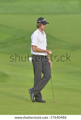 TORONTO, ONTARIO - JULY 21: Golfer  U.S.-born Australian Aaron Baddeley checks his line as he prepares to putt during a pro-am event at the RBC Canadian Open golf on July 21, 2010 in Toronto, Ontario.. - stock photo