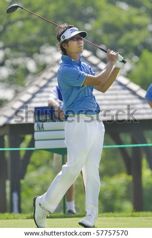 TORONTO, ONTARIO - JULY 21: Korean golfer Kevin Na follows his tee shot during a pro-am event at the RBC Canadian Open golf on July 21, 2010. - stock photo