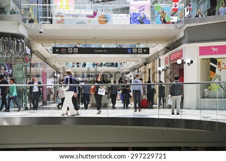 TORONTO, ONTARIO - JULY 15 2013: Shoppers in the Toronto Eaton Centre. The Eaton Centre is Toronto's premiere shopping destination and home to over 175 brand name stores, restaurants & entertainment - stock photo