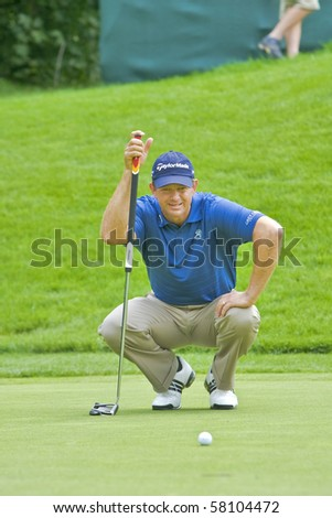TORONTO, ONTARIO - JULY 21 : South African golfer Retief Goosen lines up a putt during a pro-am event at the RBC Canadian Open golf on July 21, 2010 in Toronto, Ontario - stock photo
