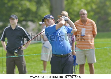 TORONTO, ONTARIO - JULY 21: South African golfer Tim Clark follows his tee shot during a pro-am event at the RBC Canadian Open golf on July 21, 2010. - stock photo