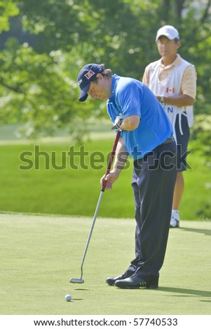 TORONTO, ONTARIO - JULY 21: South African golfer Tim Clark putts during a pro-am event at the RBC Canadian Open golf on July 21, 2010 on Toronto, Ontario. - stock photo