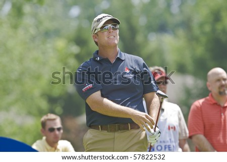 TORONTO, ONTARIO - JULY 21: U.S. golfer D.A. Points follows his tee shot during a pro-am event at the RBC Canadian Open golf on July 21, 2010. - stock photo
