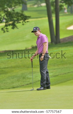 TORONTO, ONTARIO - JULY 21: U.S. golfer Hunter Mahan reacts to a missed putt during a pro-am event at the RBC Canadian Open golf on July 21, 2010. - stock photo