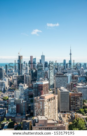 TORONTO, ONTARIO - SEPTEMBER 7: Downtown Toronto with Lake Ontario in background, in Toronto, ON, on September 7, 2013. Toronto is the 5th largest city in the continent of North America. - stock photo
