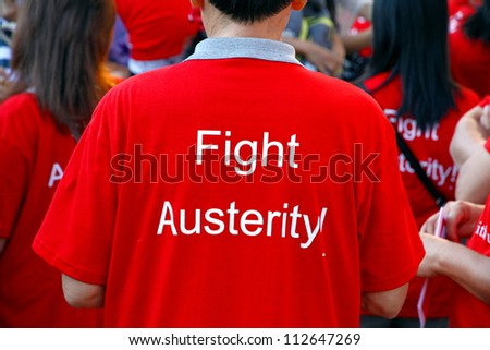 TORONTO - SEPTEMBER 3: A red t-shirt at the annual Labor Day Parade on September 3, 2012 in Toronto. The Canadian federal government is looking to cut $1 billion in federal spending this fiscal year. - stock photo