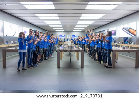 TORONTO - SEPTEMBER 19: Apple staffs cheer at the Apple Store, Eaton Centre in Toronto, Canada on September 19, 2014. Apple's newest iPhones, the 6 and the 6 Plus go on sale this day. - stock photo
