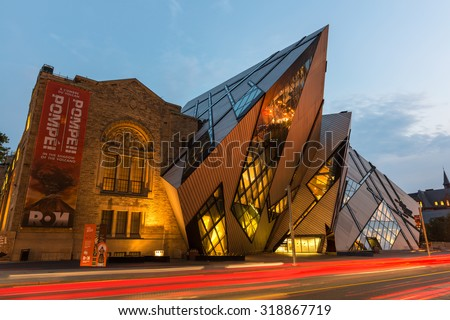 TORONTO - SEPTEMBER 8: Night wide-angle view of the North facade of the Royal Ontario Museum in Toronto, Canada, with Daniel Libeskind dramatic deconstructivist entrance, on September 8, 2015. - stock photo