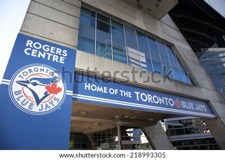 TORONTO- SEPTEMBER 15, 2014: Toronto Blue Jays baseball team logo as displayed on a banner outside of Rogers Centre in Toronto.