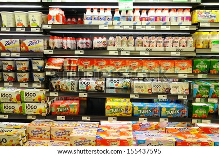 TORONTO - SEPTEMBER 14: Yogurt selection in a supermarket on September 14, 2013 in Toronto. Yogurt is nutritionally rich in protein, calcium, riboflavin, vitamin B6 and vitamin B12. - stock photo