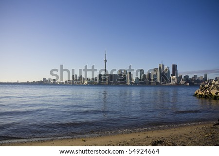 Toronto skyline as seen from toronto island shot during the day - stock photo