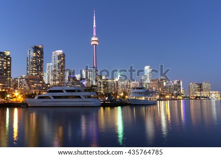 Toronto skyline at dusk over lake Ontario with colorful reflections background - stock photo
