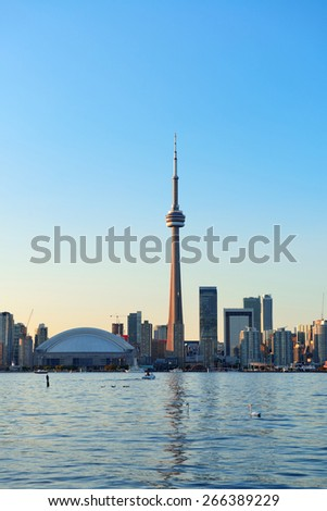 Toronto skyline in the day over lake with urban architecture and blue sky - stock photo