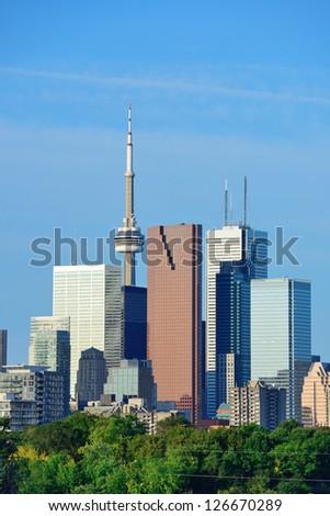Toronto skyline over park with urban buildings and blue sky - stock photo