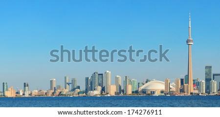 Toronto skyline panorama over lake with urban architecture. - stock photo