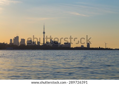 Toronto Skyline Silhouette at Sunrise from Lake Ontario with space for text - stock photo