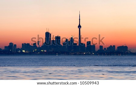 Toronto skyline with CN Tower and the financial district at sunrise - stock photo