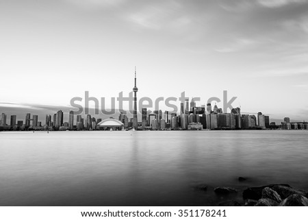 Toronto skyline with Lake Ontario in the foreground, as seen from Center Island. Long exposure, toned. - stock photo