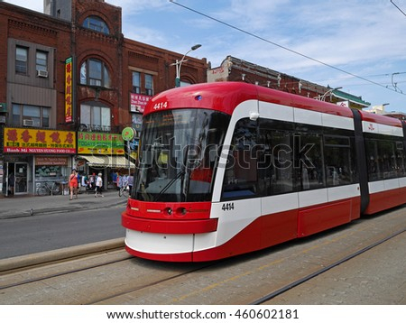 TORONTO - 2016:  Spadina Avenue in downtown Toronto is a busy area of Asian shops and restaurants, and is served by modern street cars, as seen in Toronto circa 2016.