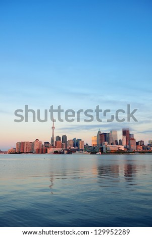 Toronto sunrise with sunlight reflection over lake in the morning - stock photo