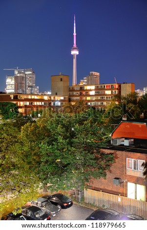 Toronto urban buildings over park with blue sky at night - stock photo
