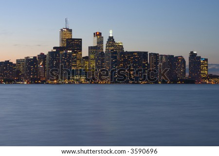 Toronto waterfront at dusk from central island - stock photo