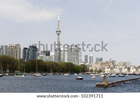 toronto waterfront with cn tower on a spring day - stock photo