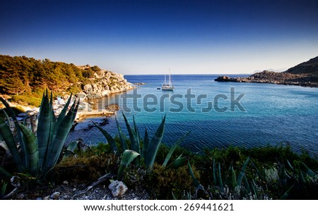torquois hidden bay in Rhodes Greece - stock photo