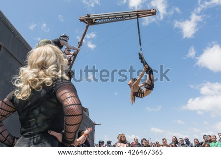 Torrance, USA - May 21, 2016: Acrobatic girl performing during 1st Annual Wasteland World Car Show.