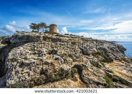 Torre de Cala Pi, medieval watchtower on the coast of Cala Pi, Mallorca, Spain, Europe - stock photo