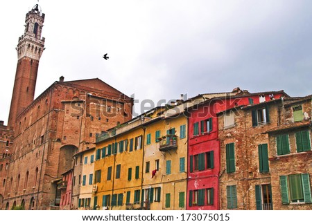 Torre del Mangia and ancient buildings, Siena, Tuscany, Italy - stock photo