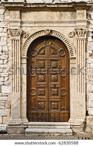 Torre del Popolo door, Assisi, Umbria, Italy - stock photo